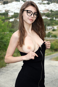 Model Milla in Undressing Outdoors